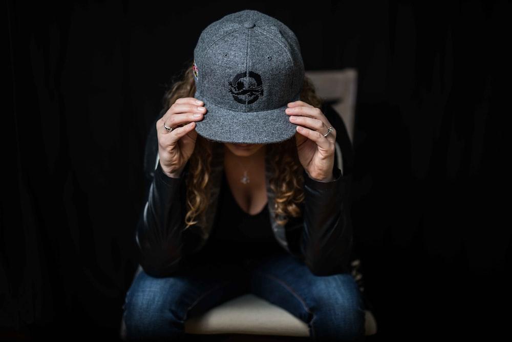woman wearing gray cap
