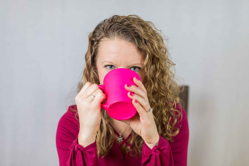 woman sipping on mug