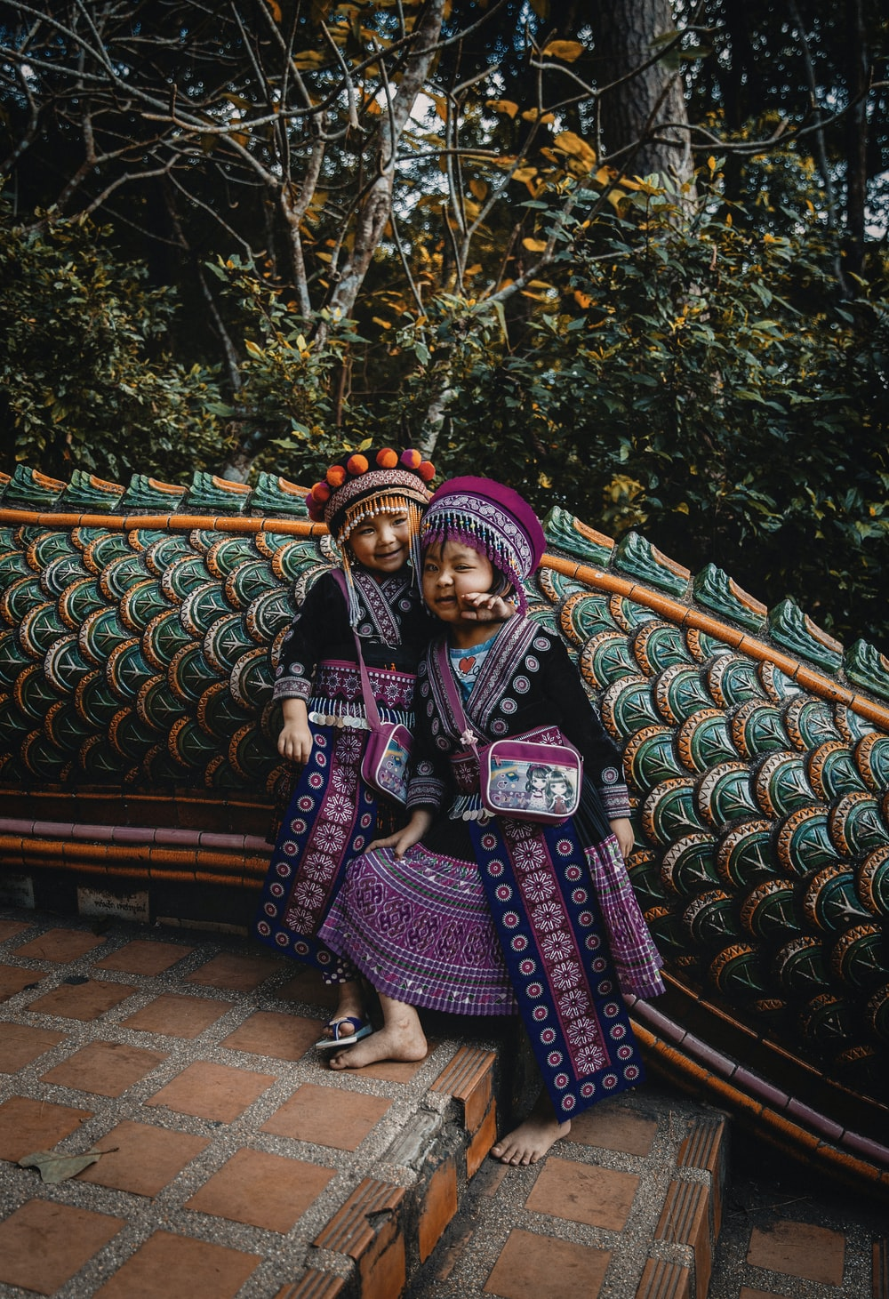 two girls wearing traditional costumes