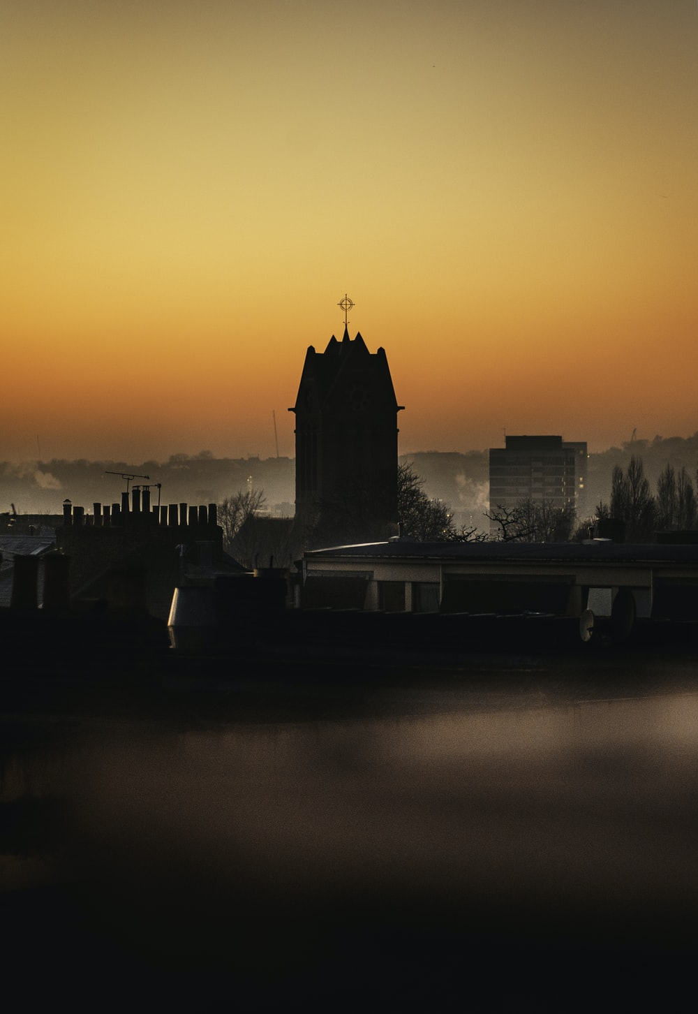 silhouette of highrise builing during golden hour