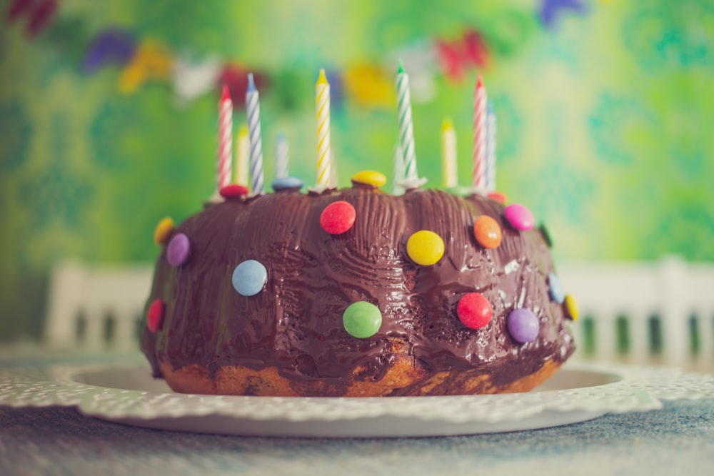 chocolate cake with nips and candles in close-up photography