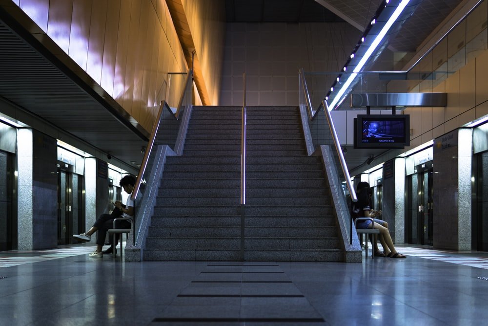 people sitting near stairs