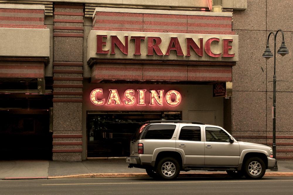 silver SUV parking beside Casino building