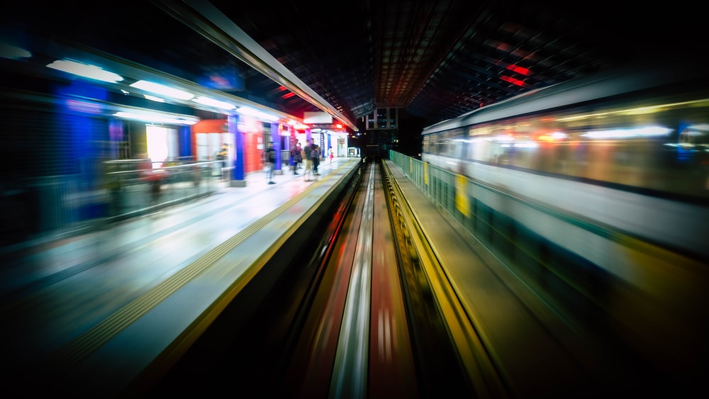 timelapse photography of train station