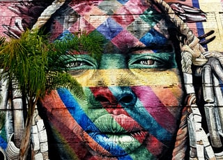 multicolored human face paint art during daytime