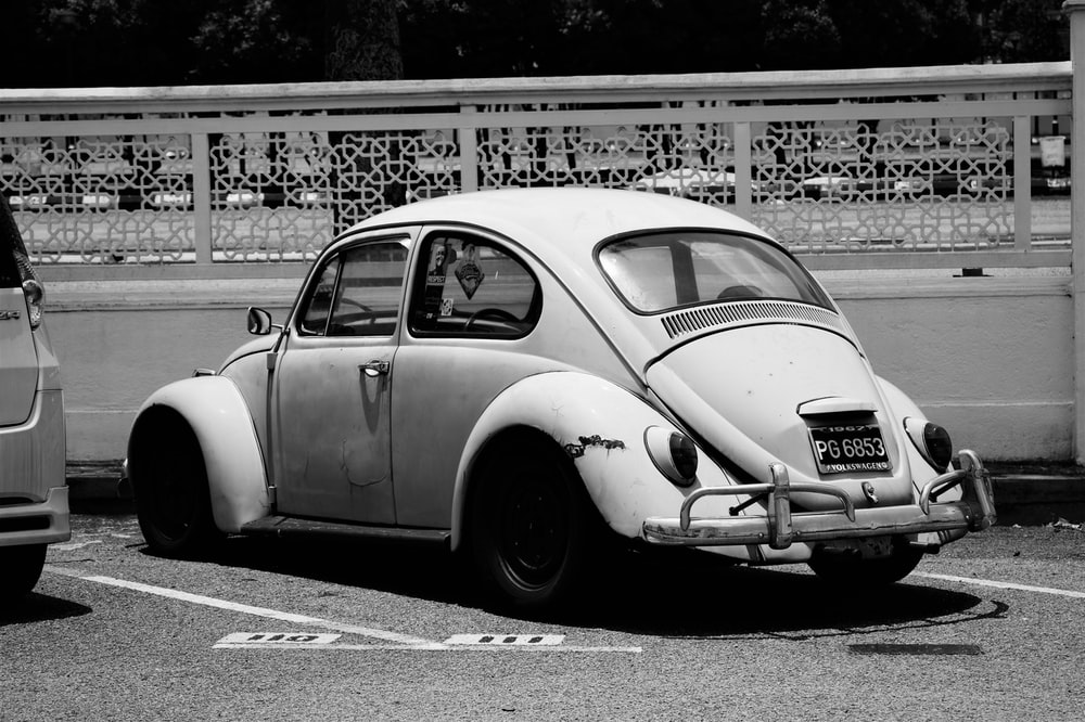grey scale photography of Volkswagen New Beetle