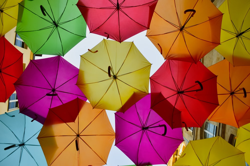 low angle photography of assorted umbrellas during daytime