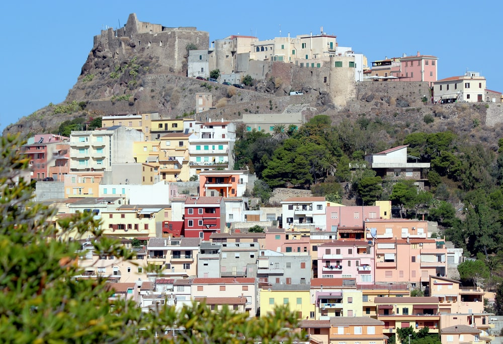 white and multicolored houses on mountain
