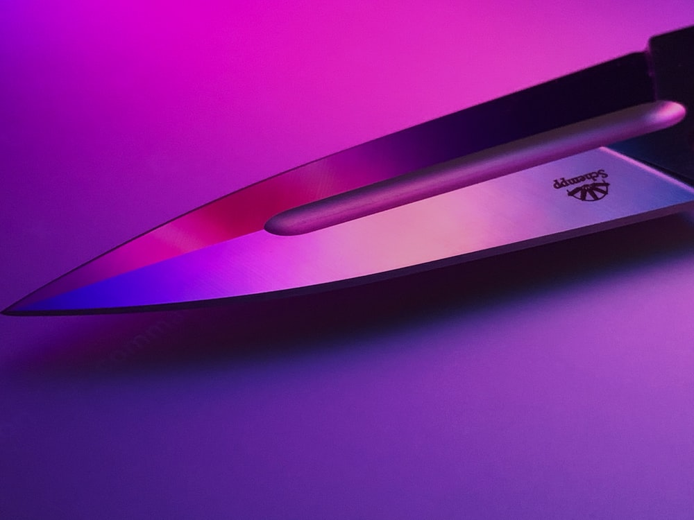 gray knife point on purple background