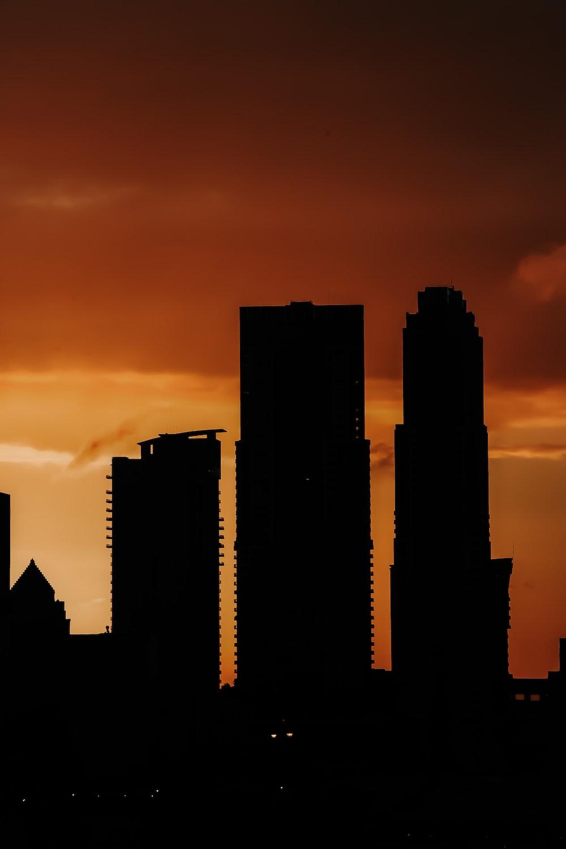 silhouette of three buildings