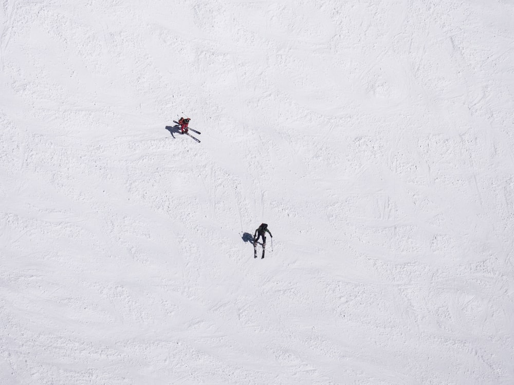 two skiers on snowfield