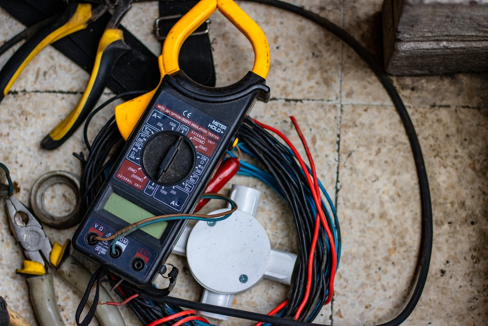 black and yellow clamp meter