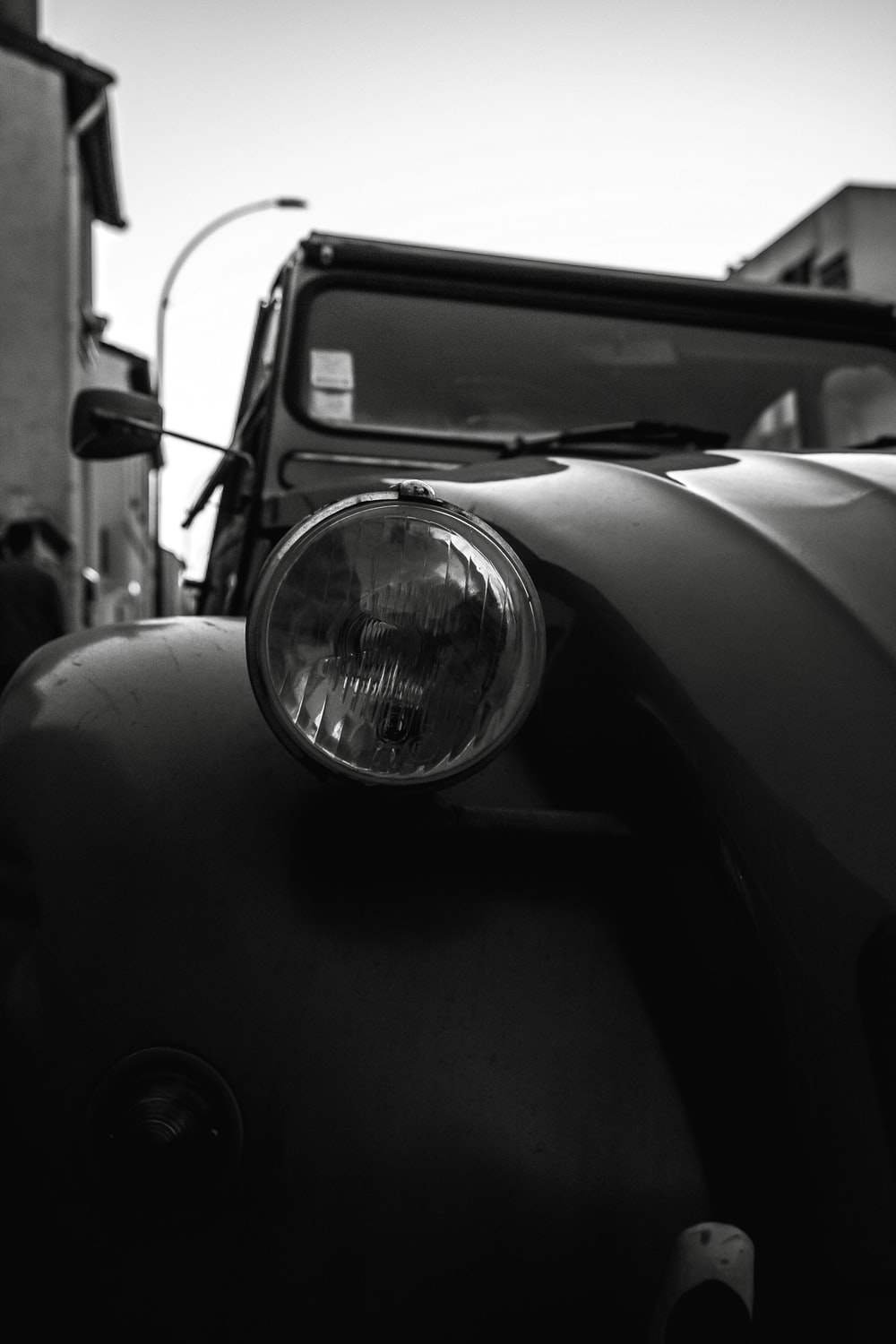 gray scale photo of vehicle
