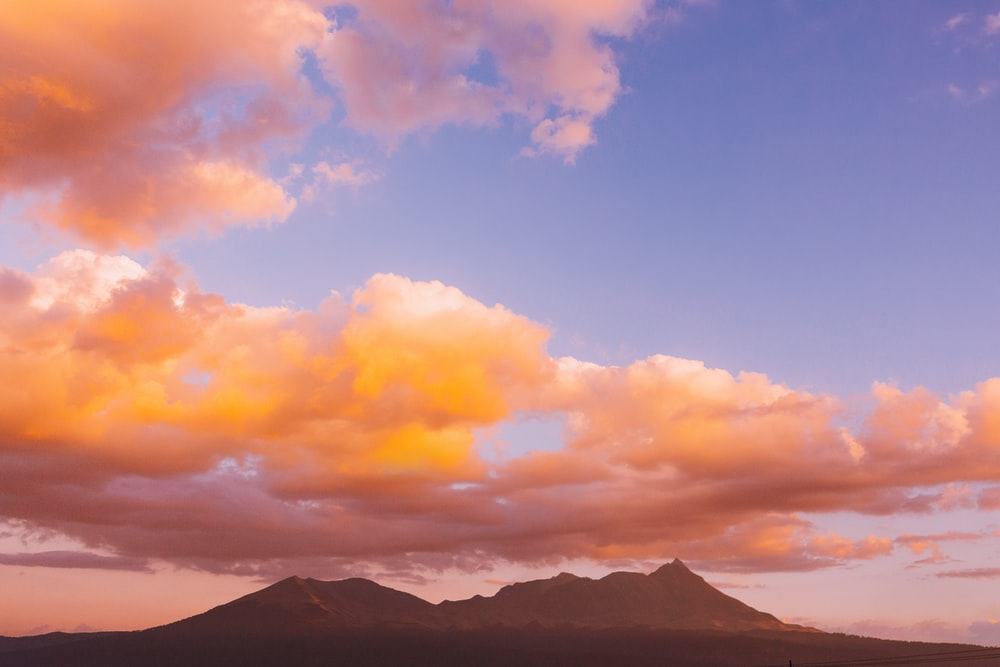silhouette photo of mountain during sunset