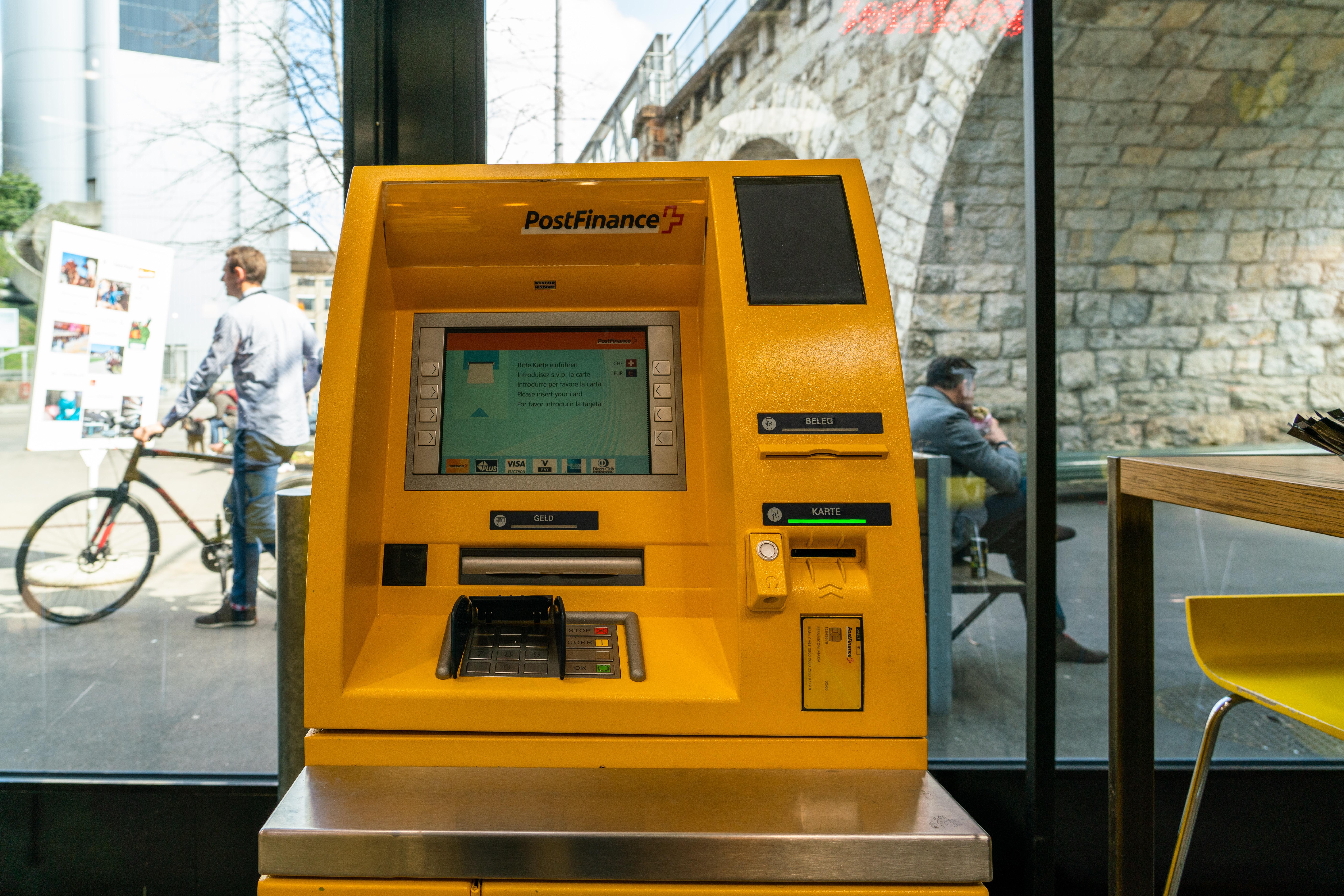 Post Finance ATM machine near glass wall