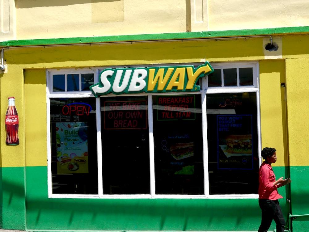 white and yellow subway signage