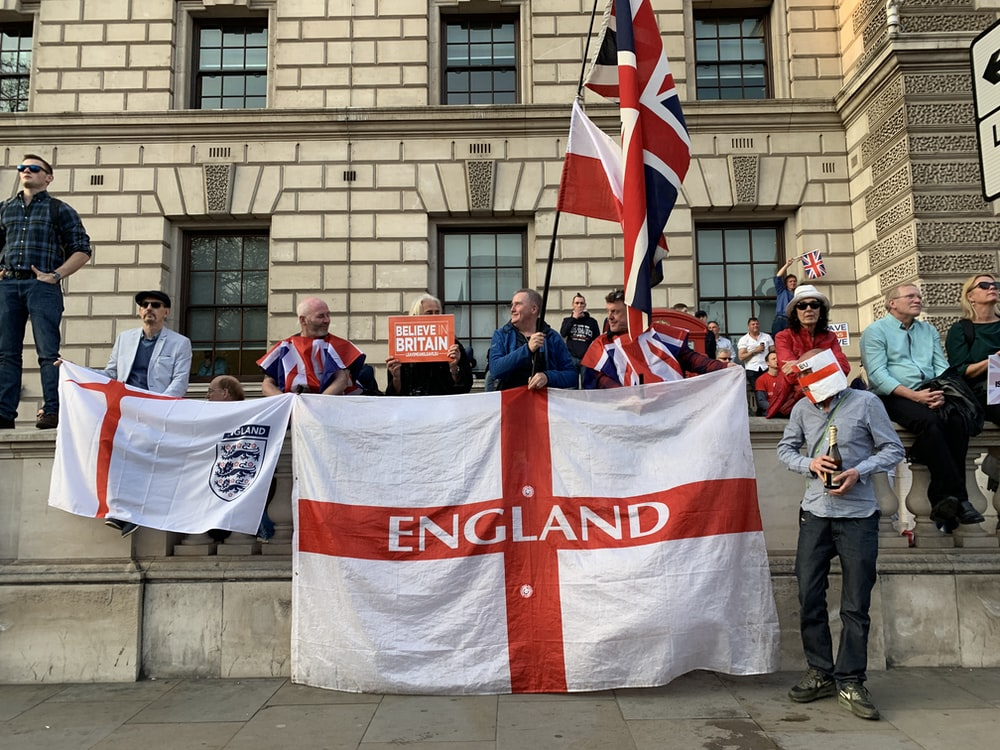 people holding England flag