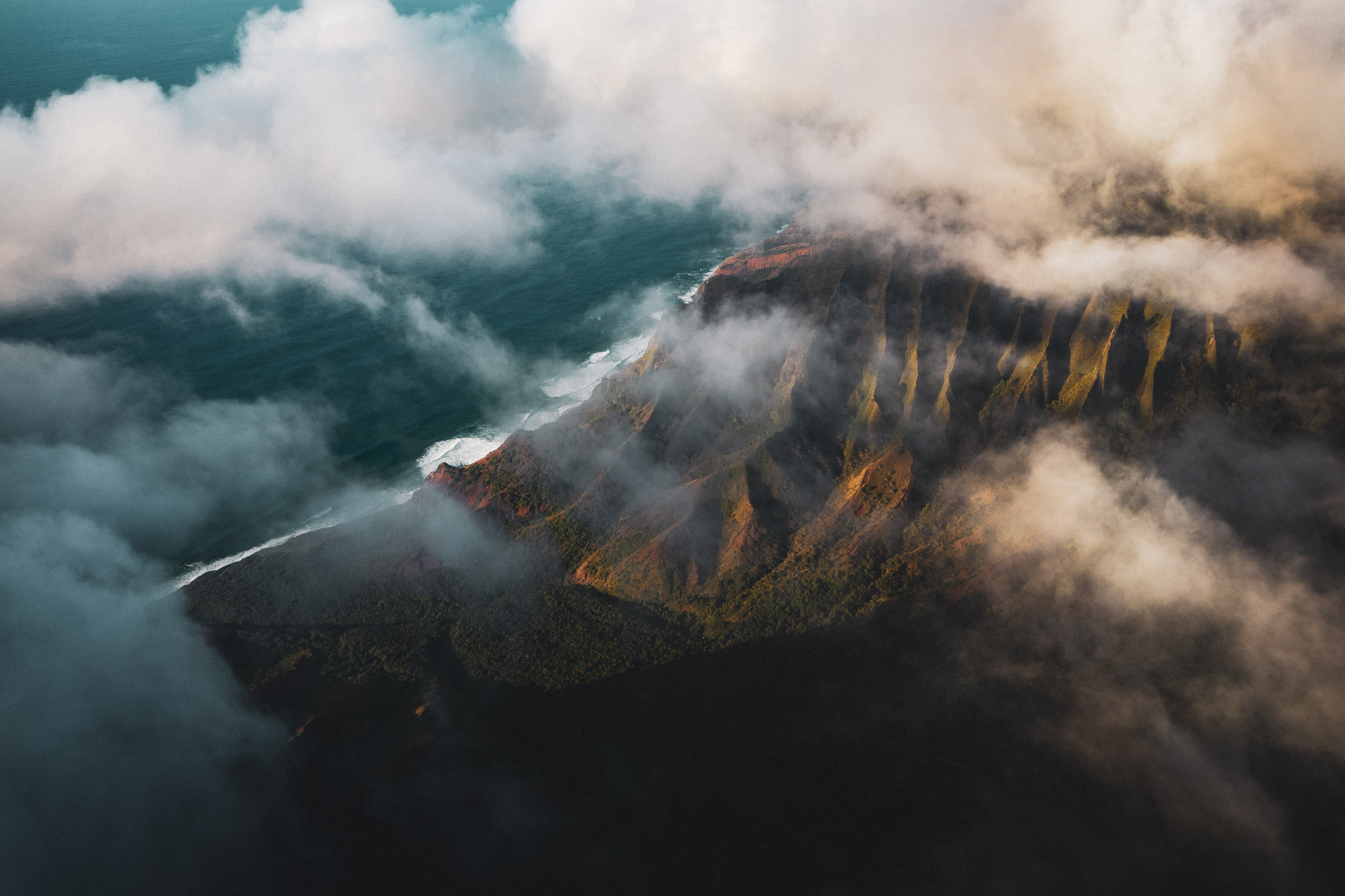 aerial photography of mountain covered with fog