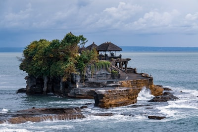 house on rock formation bali teams background