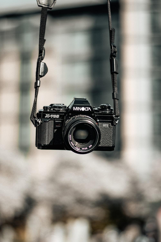 black Minolta DSLR camera selective focus photography