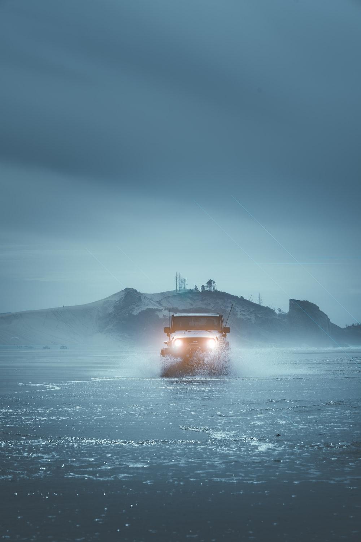 gray vehicle at water