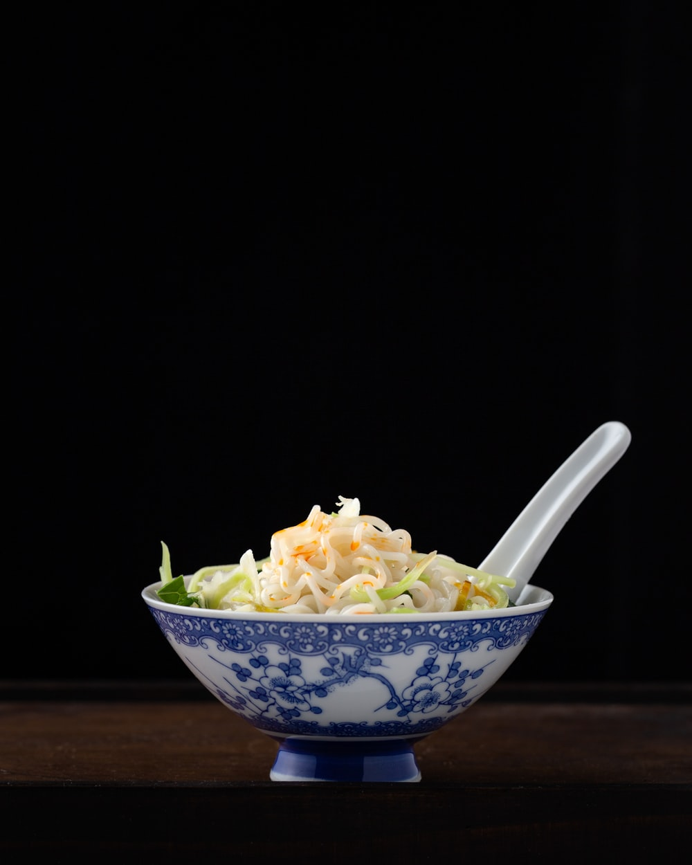 noodles in white and blur floral bowl