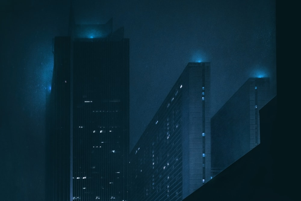 high-rise buildings at night