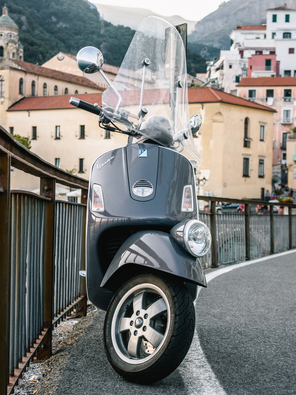 gray motor scooter parked on the street