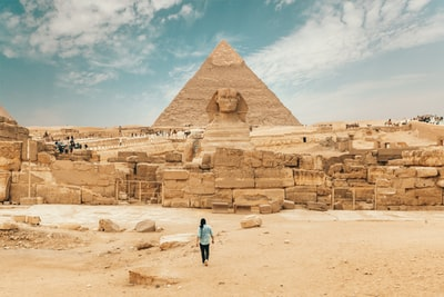 person walking near the great sphinx egypt zoom background
