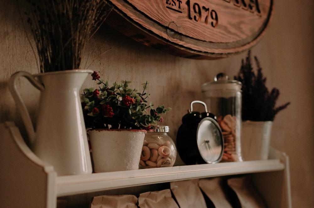 black ring bell alarm clock near clear glass cookie jar