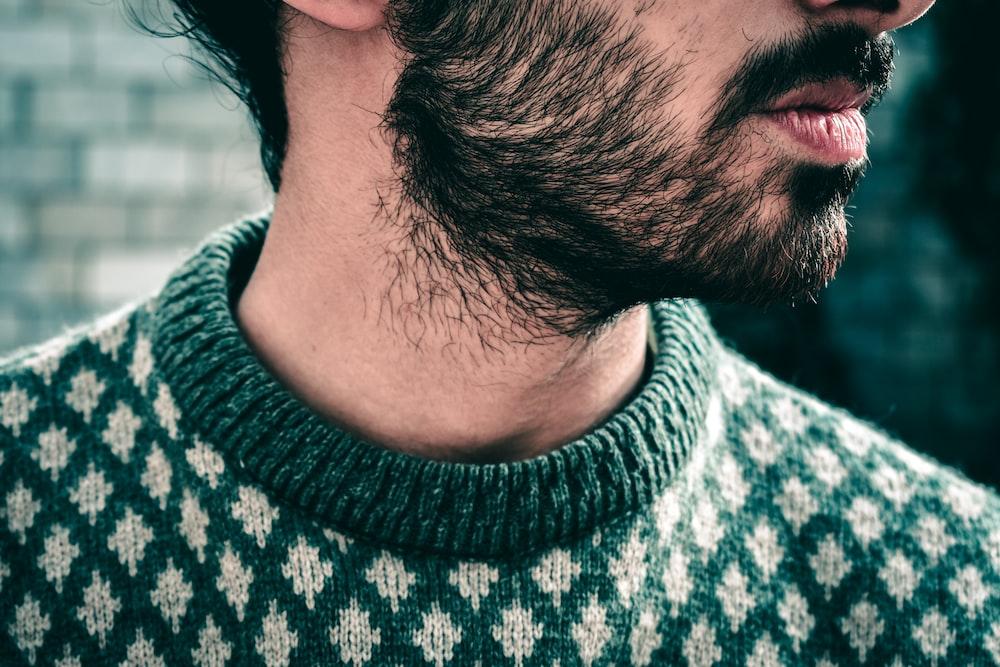 man wearing black and white knit sweater during daytime