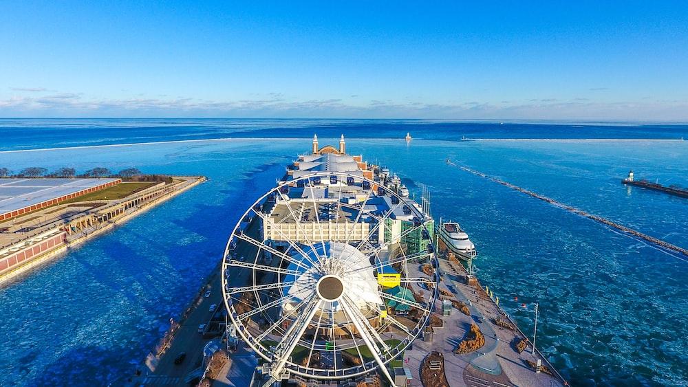 Ferris wheel in between of body of water