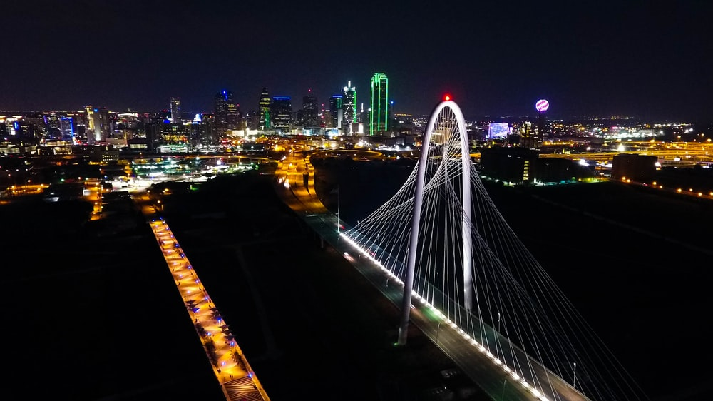 aerial photography of steel bridge during nighttime