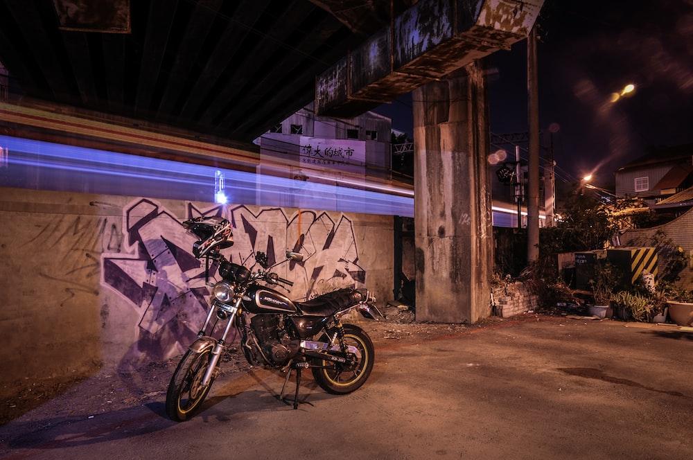 motorcycle parked near graffiti