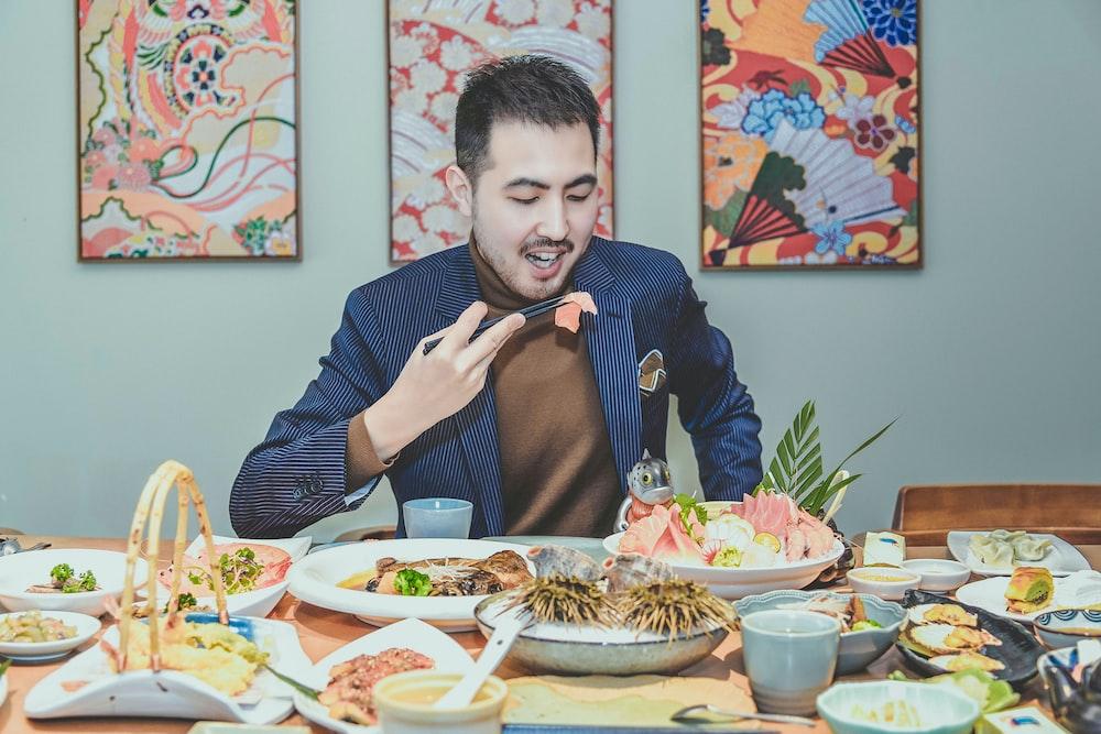 man eating around table