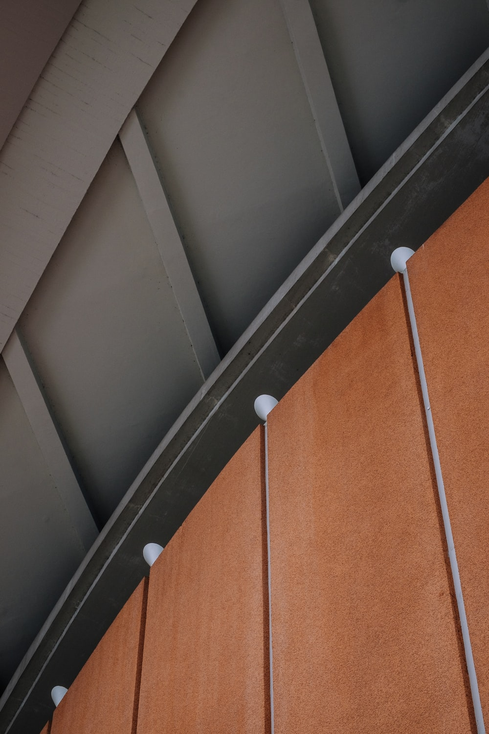 grey roof above brown wooden wall