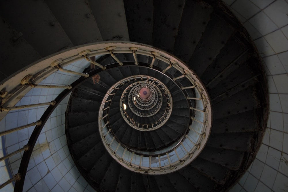 architectural photography of black and gray spiral stair