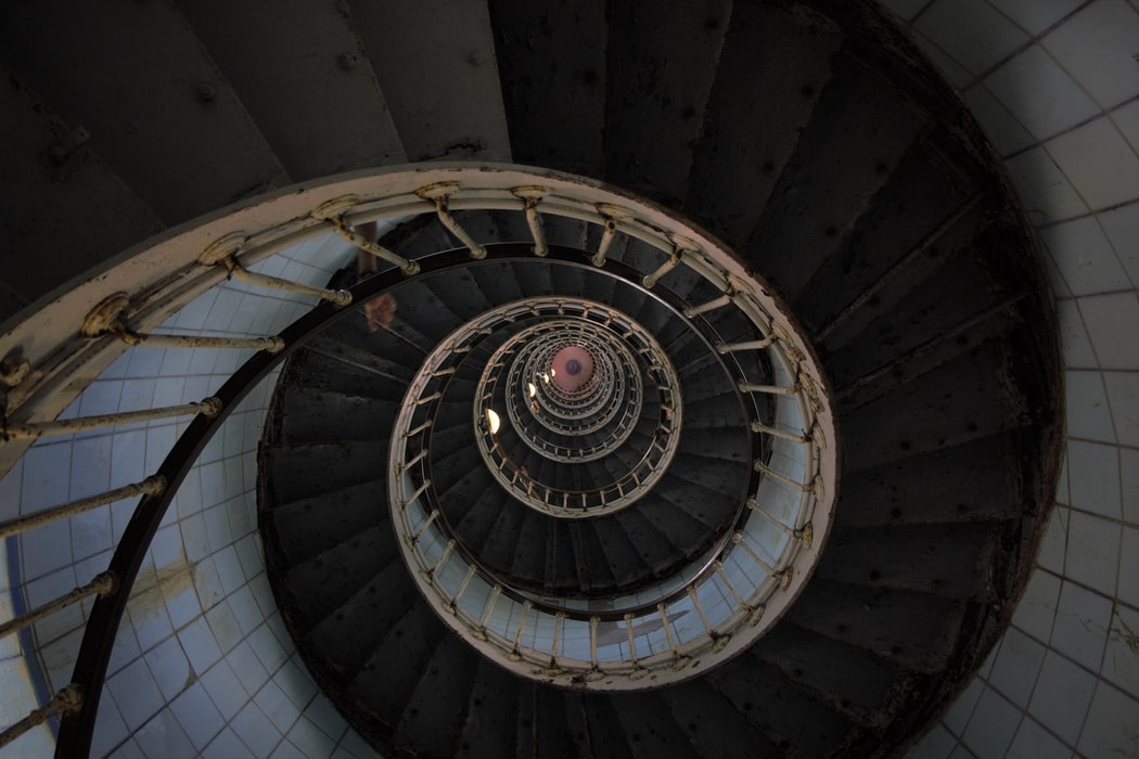 The reason firehouses have circular stairways is from the days when the engines were pulled by horses. The horses were stabled on the ground floor and figured out how to walk up straight staircases.