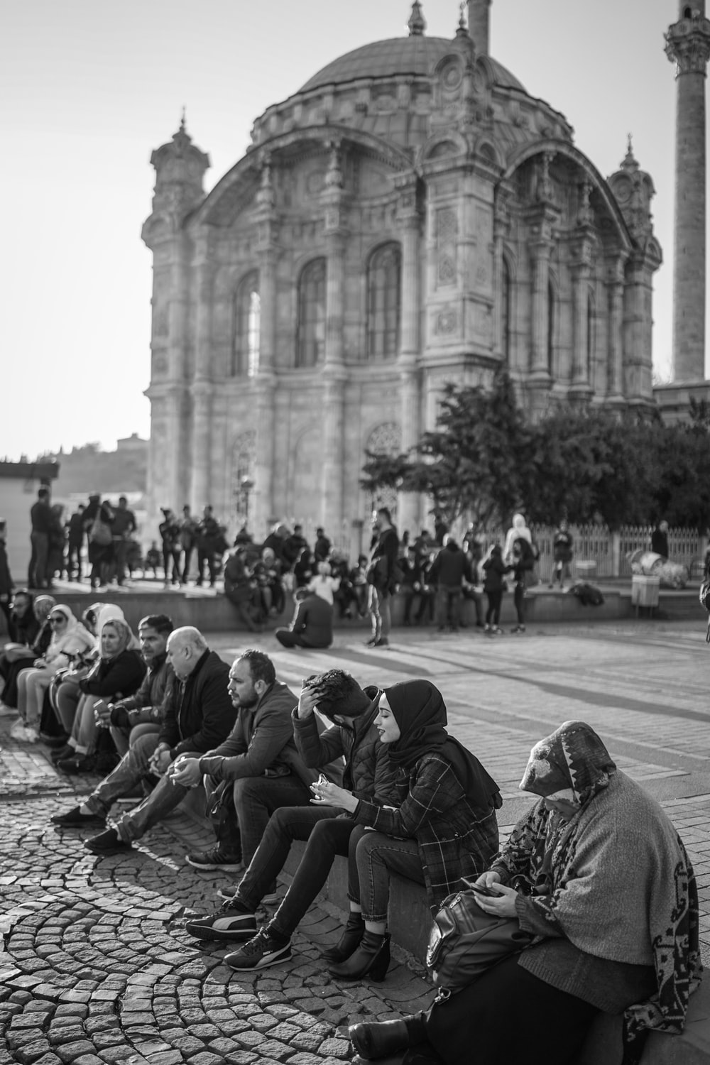 grayscale photography of people near cathedral