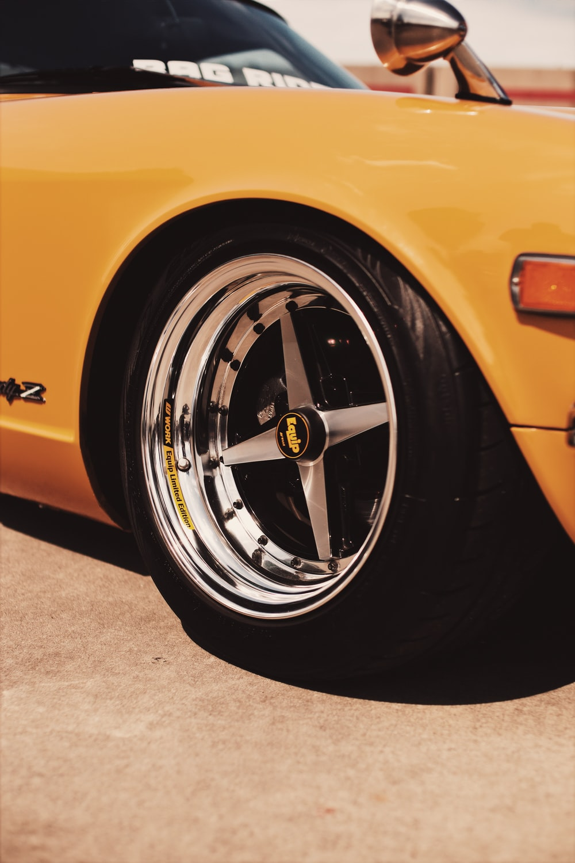 yellow vehicle on focus photography