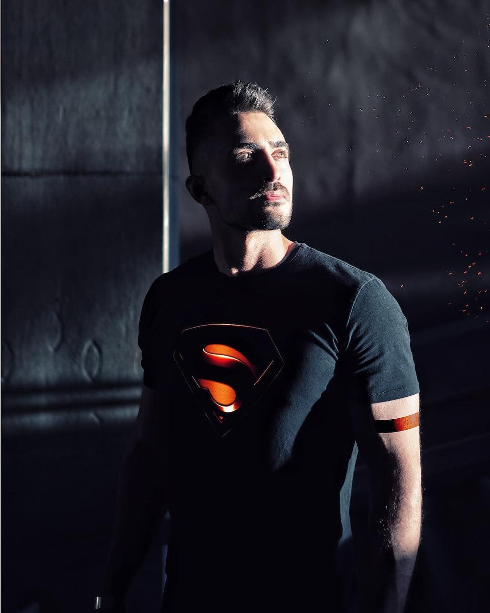 man wearing black Superman shirt