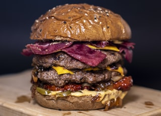 closeup photo of burger on brown surface