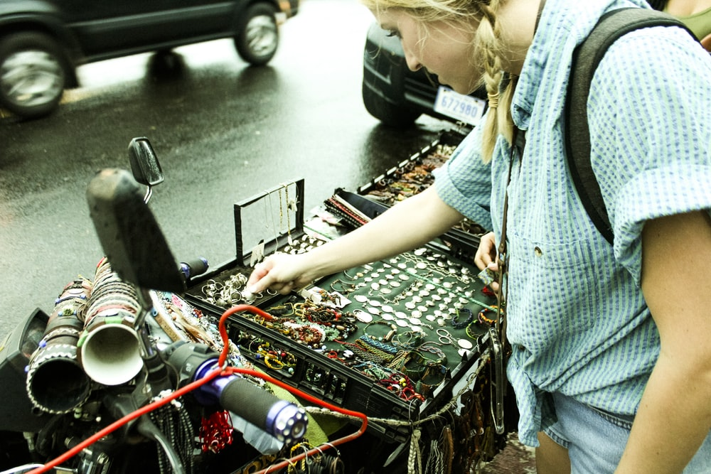 woman using audio mixer beside road