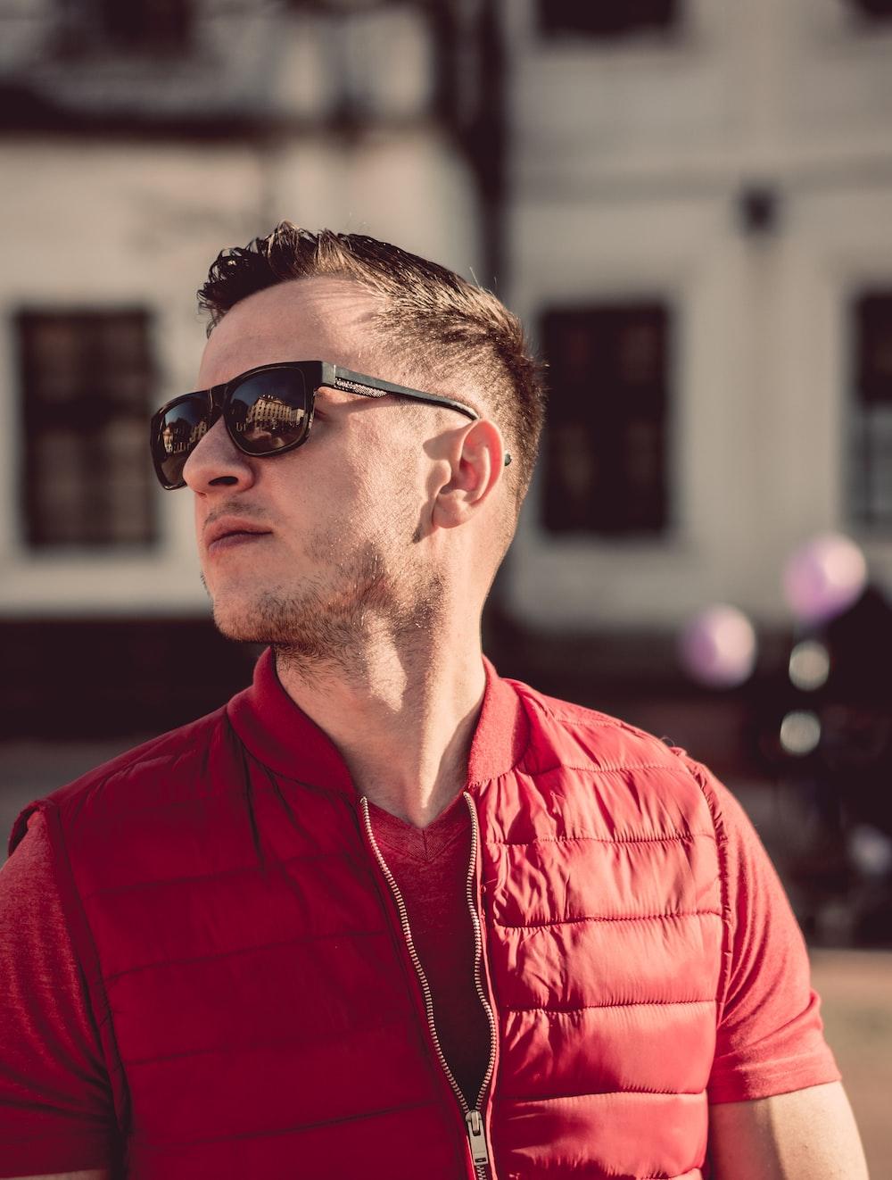 man in red zip-up top