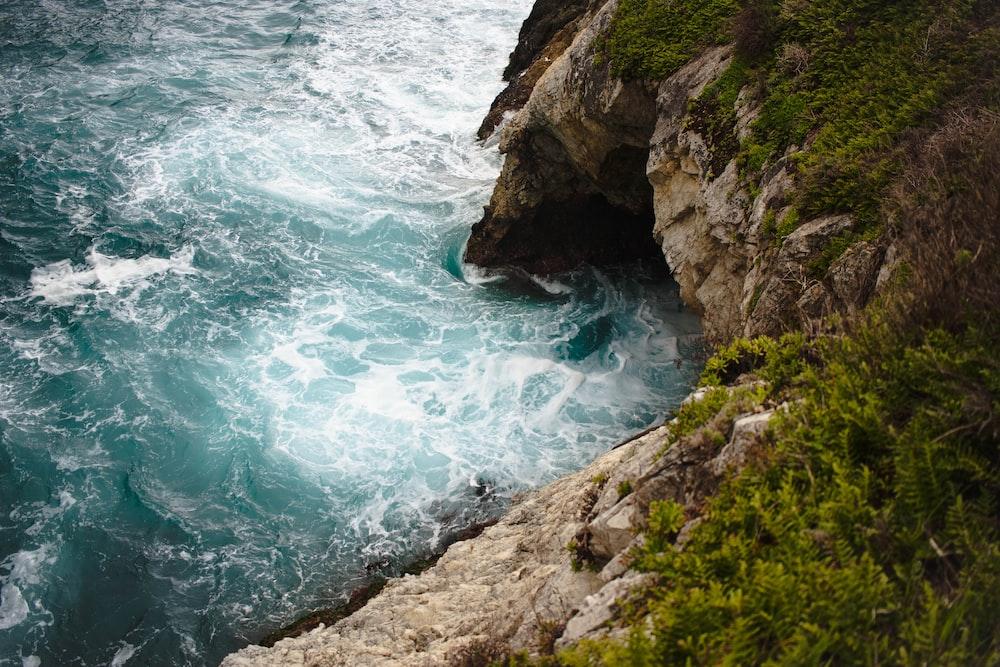 ocean waves beside island