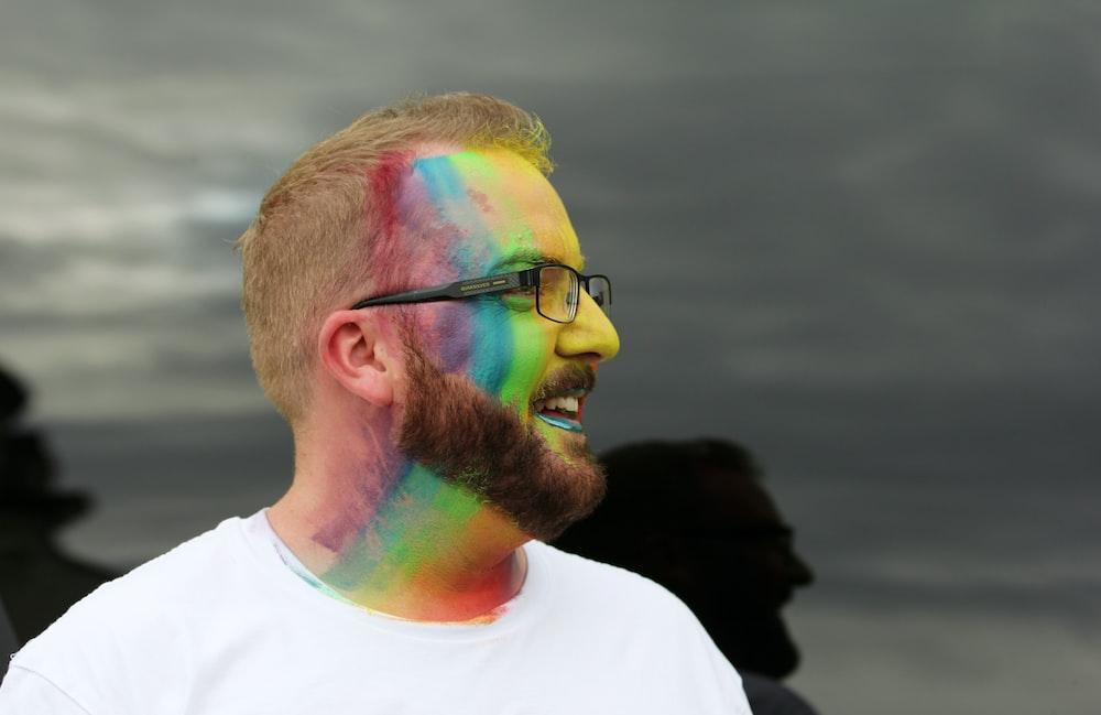 smiling man wearing eyeglasses facing his right side