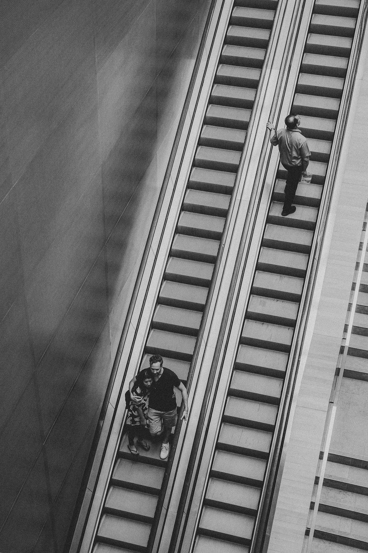 grayscale photo of man on elevator