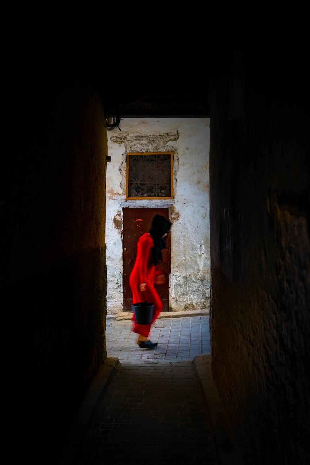 woman in red salwar kameez dress