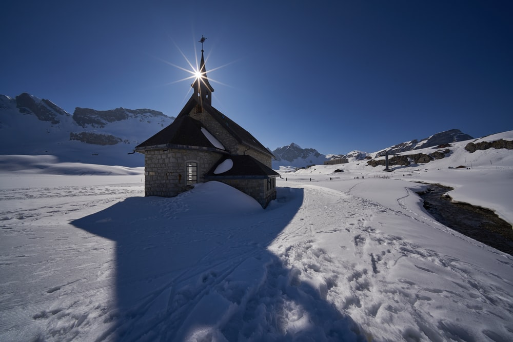 church in snow field during daytime