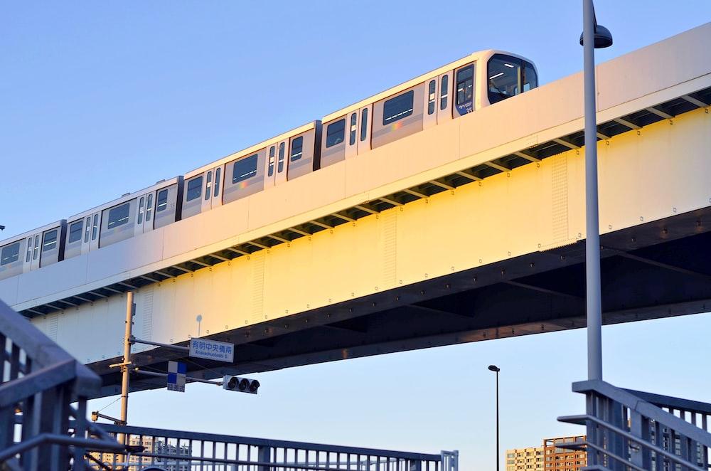 white subway on concrete bridge during daytime